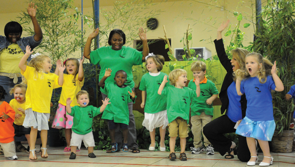 Lisa Nimmer, right, dances with children from First Steps Early Child Development Center during its student achievement program in August. (File Photo)