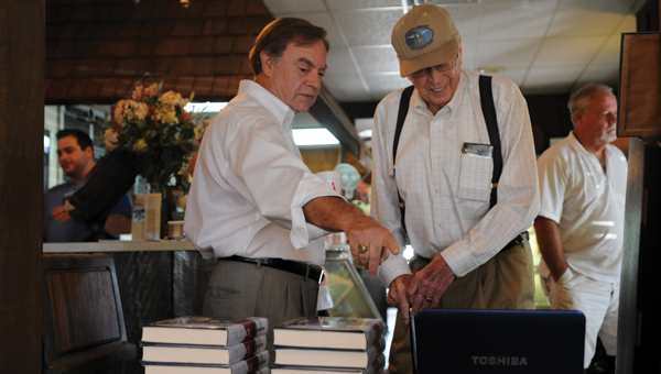 George Wallace Jr. chats with Bill Bates at a book signing at Bates House of Turkey in August of 2012. (Advocate Staff/Andy Brown)