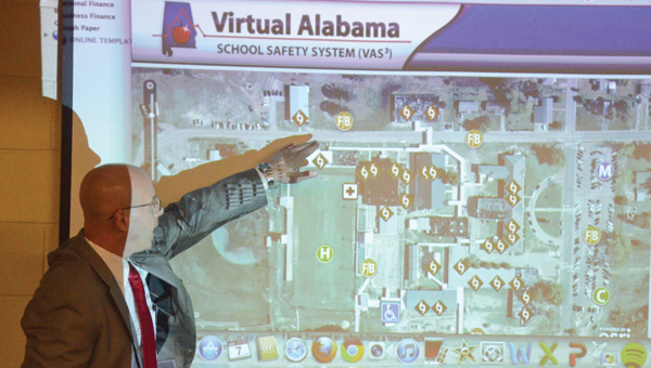 Luverne principal Greg Pittman points out an area of Luverne High School on the Virtual Alabama School Safety System at a summit with local first responders.