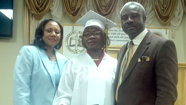 Mary McCloud recently received her General Educational Development certificate at the age of 57. McCloud's church Covenant Warriors Christian Center held a graduation ceremony for McCloud in February. Pictured are, from left to right, pastor Lois Robinson, Mary McCloud and pastor Leander Robinson. (Submitted Photo)