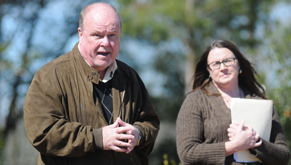 Greenville Mayor Dexter McLendon, left, and horticulturist Jennifer Stringer, right, discuss the process of constructing the city's Camellia Garden during a grand opening ceremony Monday. (Advocate Staff/Andy Brown)