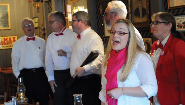 "From left to right, Frank McGinnis, David Norrell, Jerry Wilkerson, Tom Payne, April Lowery and Joni Thomas perform Stevie Wonder's ""I Just Called To Say I Love You"" to diners in Cracker Barrel on Thursday afternoon. The group performed a variety of love songs for Valentines throughout the day as a fundraiser for the American Cancer Society's Relay For Life. (Advocate Staff/Andy Brown)"