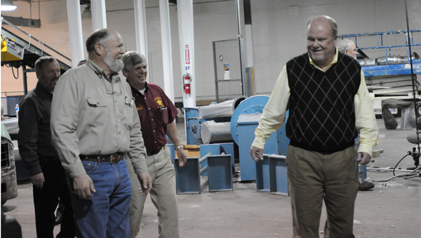 Greenville Mayor Dexter McLendon,  Director of the Public Works Department Milton Luckie, Butler County Commission Chairman Jesse McWilliams and Butler County Sheriff Kenny Harden tour the former WestPoint Home manufacturing facility. (Advocate Staff/Andy Brown)