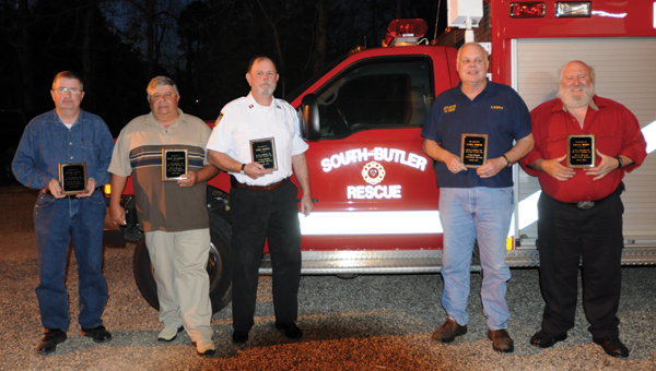 Seven or the original members of the South Butler Fire and Rescue Squad were honored Thursday night for 20 years of service to the squad. Pictured are, from left to right, Denson Scott, Kirby Blackburn, Eddie Holder, Larry Creech and Randy Wood. Not pictured are Stuart  Taylor and David Scruggs. (Advocate Staff/Andy Brown)