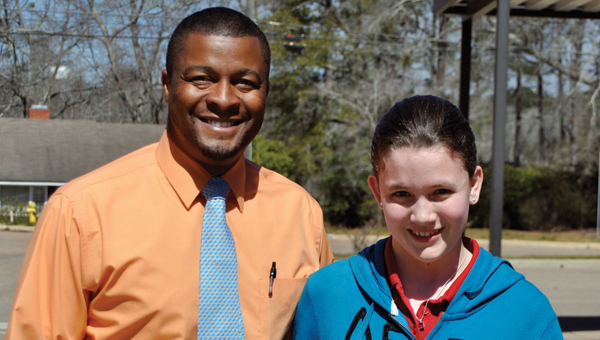 Greenville Middle School eighth grader Kaitlyn Smith advanced to the second round of the state spelling bee in Birmingham on March 9. Smith is pictured with GMS principal Curtis Black. (Advocate Staff/Fred Guarino)