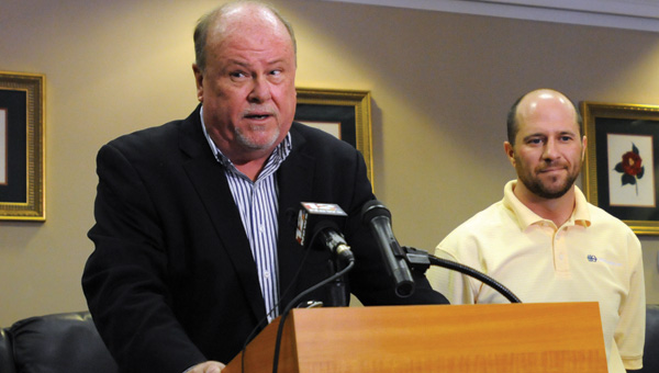Greenville Mayor Dexter McLendon, left, and Hwashin Human Resources Manager Josh Simmons, right, announce a $25 million expansion at Hwashin's Greenville facility. (Advocate Staff/Andy Brown)