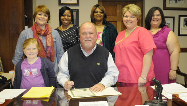 Greenville Mayor Dexter McLendon signed a proclamation Tuesday proclaiming April as Volunteer Appreciation Month in the City of Greenville. On hand for the signing were, from left to right, Alli Butts, Comfort Care Hospice volunteer; Rebecca Butts, Comfort Care Hospice Volunteer Coordinator; Lilnetta Jones, Comfort Care Hospice volunteer; Janet Lewis, Comfort Care Hospice volunteer; Melissa Jones, Comfort Care Hospice volunteer; and Meagen Cardy, Comfort Care Hospice volunteer. (Advocate Staff/Tracy Salter)