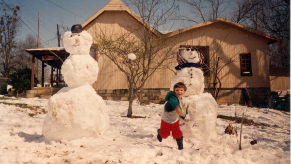 Cody Norman took advantage of the near-record snowfall to toss a few snowballs during the aftermath of the Blizzard of 1993. (Courtesy Photo)