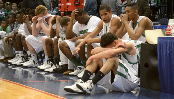 The Brantley boys sit quietly on the bench after the loss, waiting on the trophy presentation.