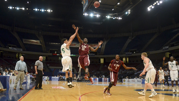 O.J. Guice shoots a three-pointer against St. Jude in the state championship game.
