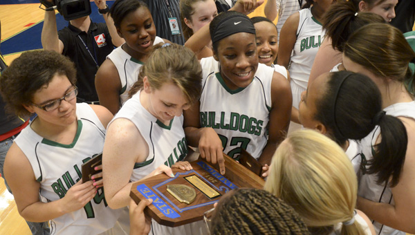 The Brantley girls celebrate with their trophy.