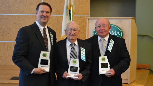 Four individuals with ties to Butler County were recently inducted in the Alabama 4-H Wall of Fame. Pictured are, from right to left, Eric Cates III, who accepted the award on behalf of his parents Eric Cates Jr. and Louise Cates; Ralph Thompson; and Rex Blackburn. (Submitted Photo)