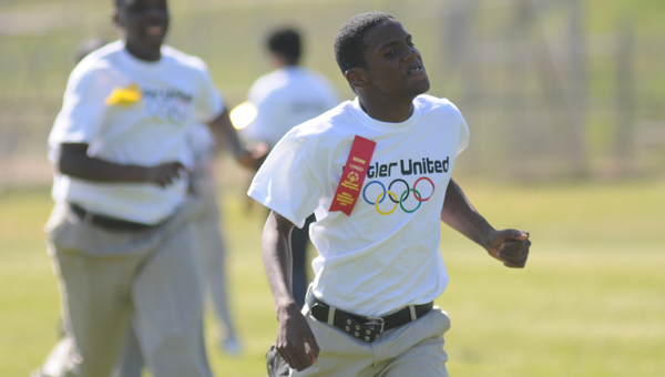 Greenville High School's Jaylon Hamilton races to the finish line during the 100-yard dash during the Butler County Special Olympics on Friday at Tiger Stadium. (Advocate Staff/Andy Brown)