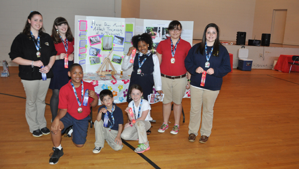 The Butler County School system recently held its countywide science fair. Pictured are, from left to right, Kaitlin Phelps, Irina Seale, Zane Lewis, Ashton Nelson, Timber Black, Amiry Bell, Sierra Newman and Cathy Odom. (Advocate Staff/Fred Guarino)