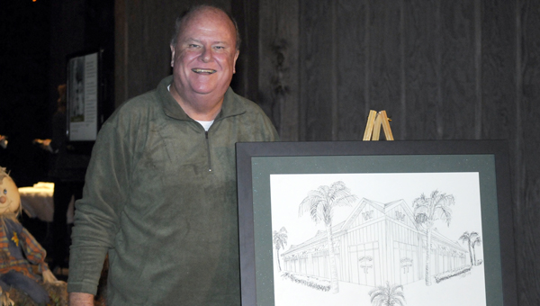 Greenville Mayor Dexter McLendon poses with a rendering of Wintzell's Oyster House. (File Photo)