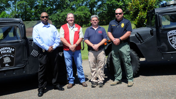 Marvin's, D&T Emergency Lighting, Greenville Class Company and Purvis Signs assisted the Greenville Police Department with refurbishing two Humvees. Pictured are, from left to right, Capt. Anthony Barganier; John Shell, Marvin's store manager; Charles Thomas, D&T Emergency Lighting; and Lt. Marcus Christianson. (Advocate Staff/Andy Brown)