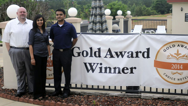 The Comfort Inn in Greenville was recently honored with the 2014 Gold Hospitality Award from Choice Hotels International. Pictured are, from left to right, James Langham, director of operations; Bhavesha Patel, general manager and owner of Comfort Inn; and Sameer Patel, APC Hospitality, LLC owner. (Advocate Staff/April Gregory)