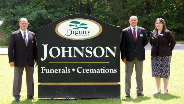 In 1914, Jim Johnson founded what is now Johnson Funeral Home. This month, the funeral home is celebrating its 100th year in business. Pictured are, from left to right, Eddie Holder, Mike Middleton and Amanda Gomillion. (Advocate Staff/Morgan Burkett)