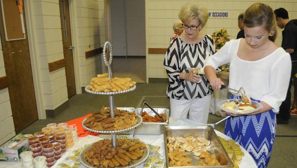 Janice Faulk (left) and Summer Stephens (right) sample Chicken Shack's offerings.