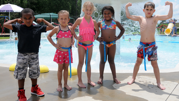 Braylin Jenkins, Anderson Garner, Kenadie Mount, Kaylee Faulk, and Austin Norman pose beside the pool at the Greenville YMCA. All four are participants in the Healthy Kids program. (Advocate Staff/Tracy Salter)