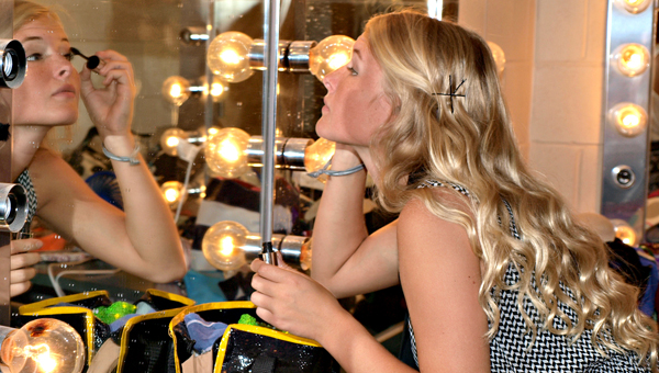 """Dancer Madeline Speir sweeps on mascara in the dressing room as she prepares for Saturday's performance of """"Hollywood Dreams."""" (Photo courtesy of Angie Long)"""