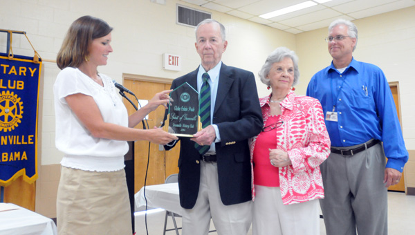 Rotary Club past president Angie Rogers presents Elisha Poole with the club's Spirit of Greenville Award on Thursday. Pictured are, from left to right, Rogers, Elisha Poole, Juanita Poole, and club president David Norrell. (Advocate Staff/Andy Brown)