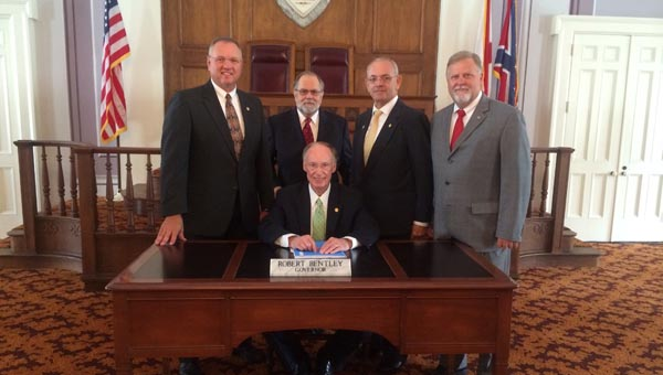 Members of the Alabama Funeral Directors Association were on hand when Gov. Robert Bentley signed Senate Bill 98, which ensures that money paid for pre-need services and merchandise is placed in trust within 30 days of payment to the funeral homes in accordance with a schedule established in the legislation. (Submitted Photo)