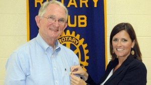 Angie Rogers presents a pin to Dr. Jim Krudop (right) signifying his status as a Paul Harris Fellow. (Advocate Staff/Jonathan Bryant)