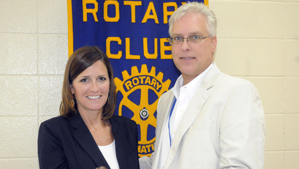 David Norrell was inducted as president of the Rotary Club of Greenville at the club's June 26 assembly. Norrell (right) was presented with the gavel by previous club president Angie Rogers (left). (Advocate Staff/Jonathan Bryant)