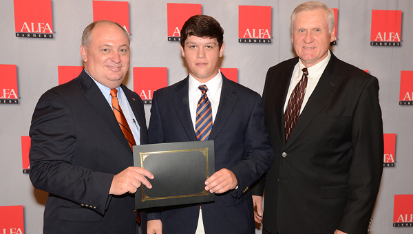 Auburn University student and scholarship recipient Dalton Burns of Butler County was honored at the Alabama Farmers Federation 2014 Scholarship Recipients Luncheon Aug. 23 at the Grand National Hotel in Opelika. Burns is studying forestry. The scholarship was funded by the Butler County Farmers Federation. From left are AFF President Jimmy Parnell, Burns and Butler County Farmers Federation President Percy Thompson. (Courtesy Photo)