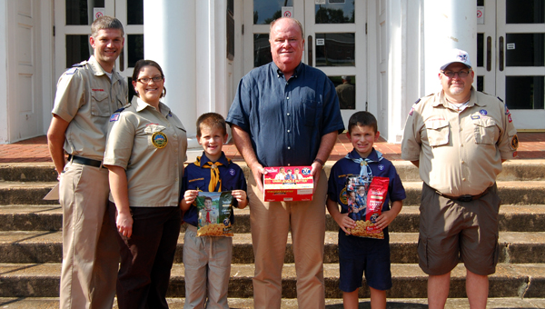 Local Cub Scouts and Boy Scouts kicked off their annual popcorn sale on Monday with the help of Greenville Mayor Dexter McLendon. Pictured are, from left to right, Jamie Odom, Keri Ann Odom, Peyton Ridgeway, Dexter McLendon, Blaine Ridgeway and Mike Earnest. (Advocate Staff/Morgan Burkett)
