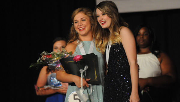 Cailyn Thompson was selected as Butler County's Distinguished Young Woman on Saturday night. Thompson, a senior at Fort Dale Academy, also won the Spirit of Distinguished Young Women Award and the fitness portion of the competition. Thompson was presented her medallion by last year's Butler County Distinguished Young Woman Sierra Teate. (Advocate Staff/Andy Brown)