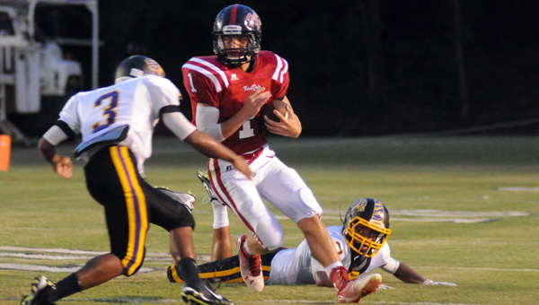 Fort Dale Academy senior Ryan Burkett rushed for 65 yards and three touchdowns on six carries in the Eagles' 59-6 win over Evangel Christian Academy. (Advocate Staff/Andy Brown)