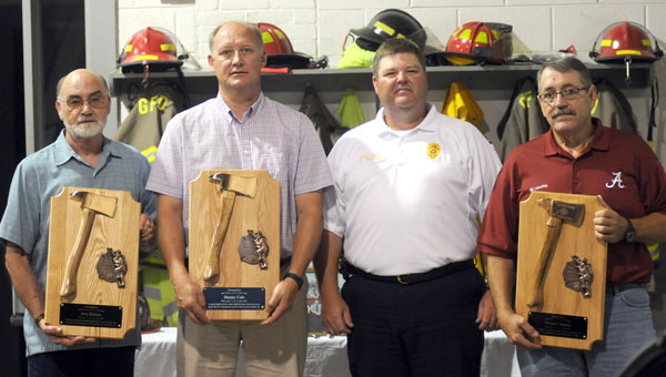 """The Greenville Fire Department held a retirement ceremony Tuesday for three longtime firefighters. Pictured are, from left to right, Dan Hutton, Jimmy Cole, Chief Chad Phillips, and Phillip """"Peanut"""" DePolo. (Advocate Staff/Andy Brown)"""