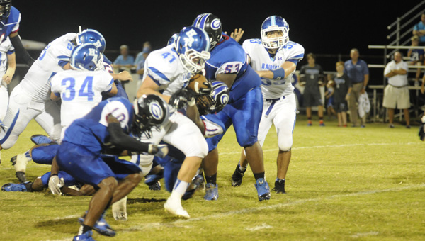 Georgiana School's Javores Brown (53), Travales Smith (11) and Jacquez Payton (10) bring down a Houston Academy ballcarrier during the Panthers' 33-0 win Friday night. (Advocate Staff/Devin Smith)