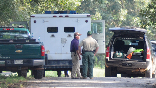 Butler County Sheriff Kenny Harden observes as a negotiator talks with a suspect who allegedly shot his wife early Tuesday morning before entering into an eight-hour standoff with authorities. (Advocate Staff/Andy Brown)