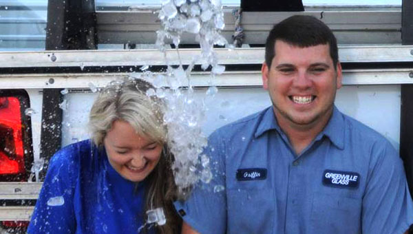 Lacy and Griffin Huggins, along with staff members from Greenville Glass Co., took the ice bucket challenge on Monday in memory of Lacy's mother, Lisa Gray, who lost her battle with ALS in 2011. (Advocate Staff/Tracy Salter)