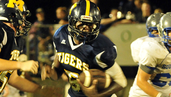 McKenzie School senior quarterback Terrance Clemons breaks free for a 64-yard touchdown during the Tigers' 48-14 win over Highland Home School Friday night. (Photo courtesy of Bryan Campbell)