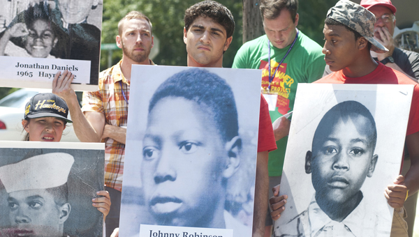 During the procession from the Lowndes County Courthouse to the jail where Jonathan Myrick Daniels was kept for six days and then on to the former Varner's Cash Store where he was fatally shot, youth carried posters of Civil Rights martyrs from Alabama. (BNI Staff/Justin Averette)