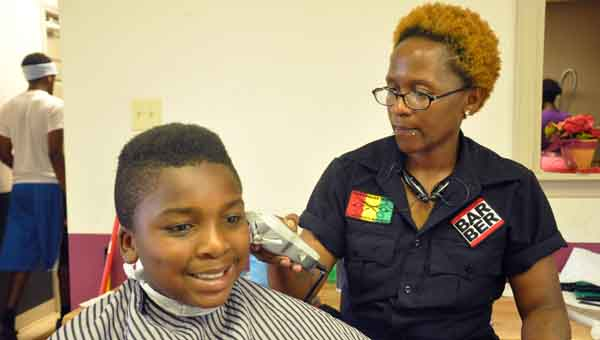 Barber Tvedt Belcher gives 12-year-old Zymoriam Smith a mohawk for school. LUVERNE PHOTO | MONA MOORE