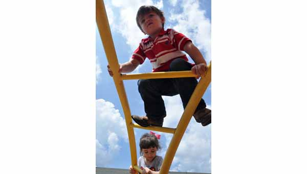 Luverne School Pre-K students Dalton Bell and Isabella Mount handle their first day on the playground as fearlessly as their first day in class.  JOURNAL PHOTO | MONA MOORE