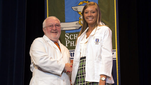 Greenville native Anne Carol Branum was among the 149 students that took part in a white coat ceremony Aug. 16 at Auburn University's Harrison School of Pharmacy. She is pictured with Associate Dean for Academic and Student Affairs Paul Jungnickel. (Submitted Photo)