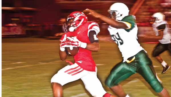 LUVERNE JOURNAL PHOTO | MONA MOORE Ke'Vontae May makes dodges a Lion as he picks up a few yards for LHS.