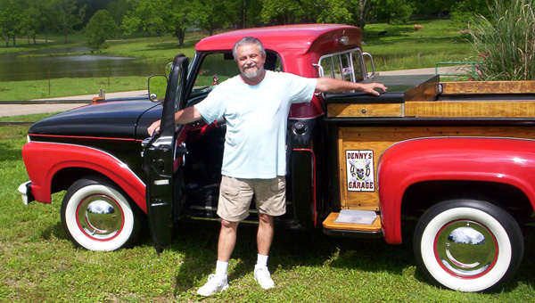 """Denny Lambert poses with his 1965 Ford F-100. The pickup is one of a handful of classic vehicles, including a 1939 Chevrolet pickup and a 1977 Corvette, that Lambert considers his """"toys."""" (Courtesy Photos)"""
