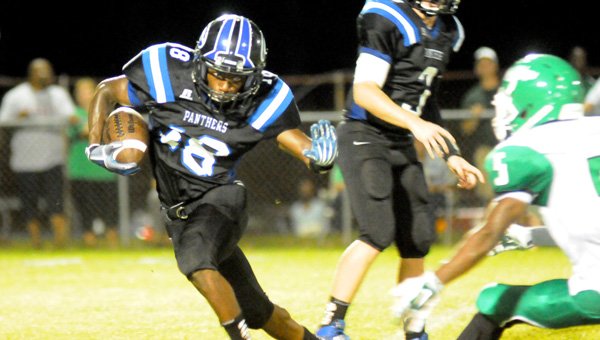 Georgiana School senior Marvin Posey looks for running room during the first half of the Panthers 44-40 loss to Brantley High School Friday night at Harmon Field. (Advocate Staff/Andy Brown)