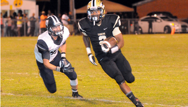 Greenville High School senior running back Alyric Posey looks for running room during the Tigers' 15-14 loss to Class 7A Alma Bryant High School. (Advocate Staff/Andy Brown)