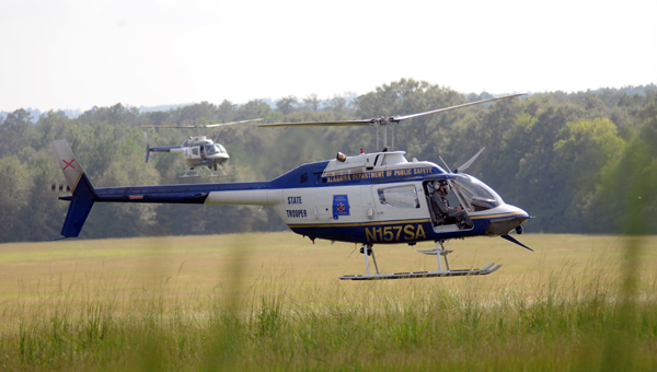 Multiple law enforcement agencies from Alabama, Mississippi and South Carolina, along with the Federal Bureau of Investigations took part in Tuesday's search, which covered a 50-mile area from Butler County to Wilcox County. (Advocate Staff/Andy Brown)