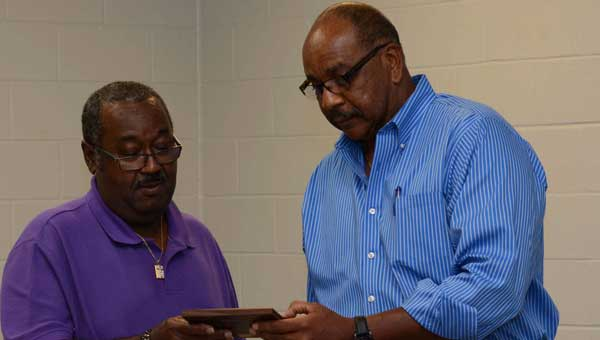 Dothan Leisure Services Director Elston Jones presented Jerome Harris with a lifetime membership in the Greenville Parks and Recreation Department.