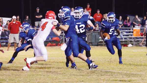 CONTRIBUTED PHOTO | MERICA TISDALE Jamal Sanders (5) races down the field as (left to right) Colten Kelley, Dalton Weeks and Collin Halloway hold off Abbeville.