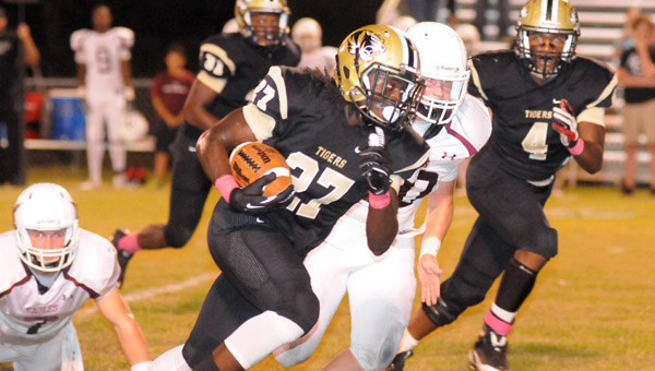 Greenville High School senior linebacker Parrish Patton returns an Alabama Christian Academy fumble 29 yards for a touchdown during the Tigers' 62-20 win Friday night at Tiger Stadium. (Advocate Staff/Andy Brown)